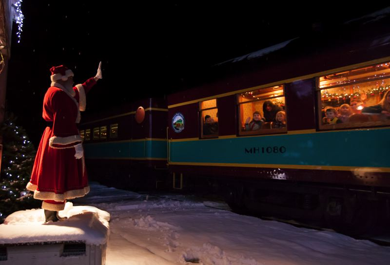 COURTESY: LOU HAMMOND GROUP - Santa Claus greets riders of Oregon's The Polar Express.