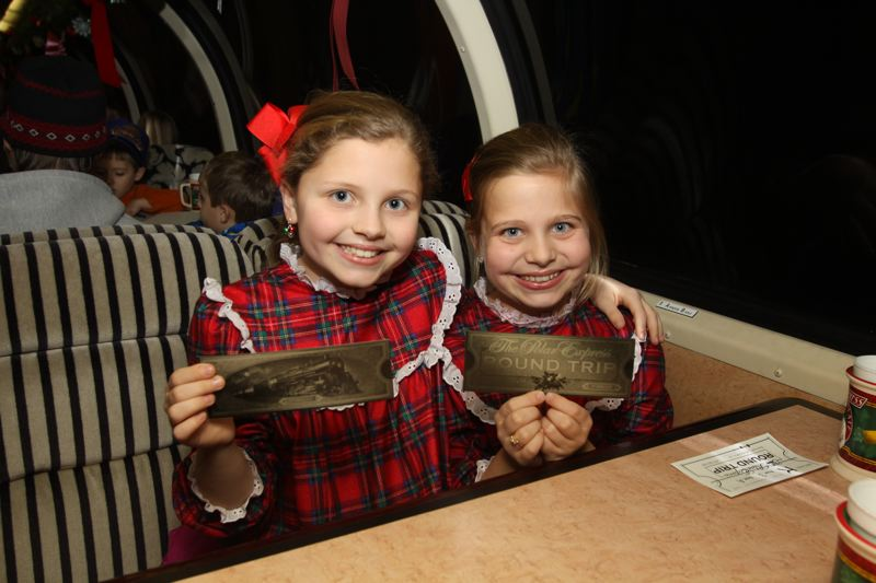 COURTESY: LOU HAMMOND GROUP - Children display their 'golden ticket' aboard The Polar Express.