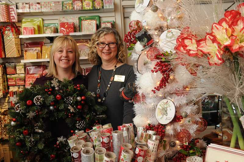 STAFF PHOTOS: VERN UYETAKE  - Floral designer Holly Goble, left, and Terri Strandberg, Palisades Floral manager, have stocked Palisades Floral with holiday gifts and decorating items. They invite the public to a holiday open house Saturday from 10 a.m. to 4 p.m. at the store, located at 1377 McVey Ave. in Lake Oswego.
