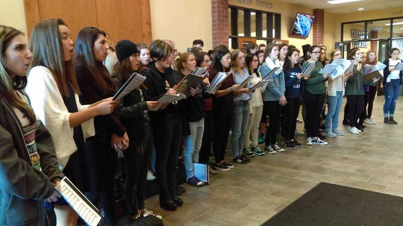 REVIEW PHOTO: JILLIAN DALEY - Lake Oswego High School A Cappella Choir students rehearse Morten Lauridsen's 'O Magnum Mysterium' in the high ceiling of the lobby at their school on Nov. 18.