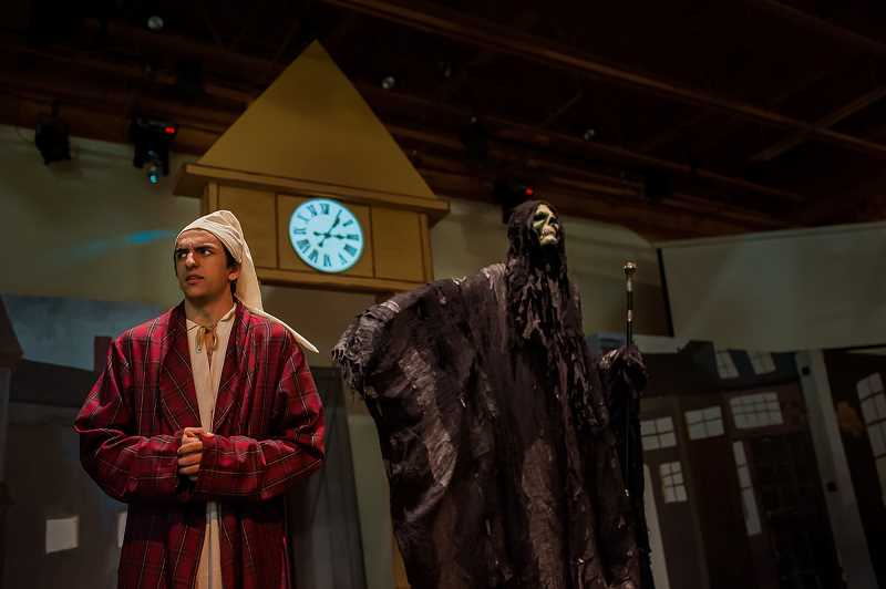 KAREN HAWLEY PHOTOGRAPHY - Brook Mackaness, left, plays Scrooge haunted by the Ghost of the Christmas Future, played by Alex Turner, in Corbett Childrens Theater's 'A Christmas Carol,' which wraps up its run Dec. 10.