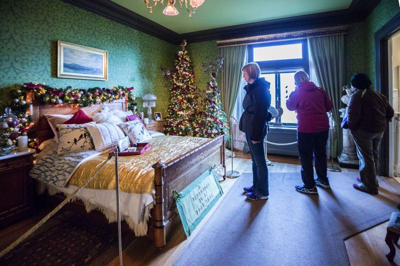 TRIBUNE PHOTO: JONATHAN HOUSE - Guests at Pittock Mansion check out the various rooms decorated for the holidays.