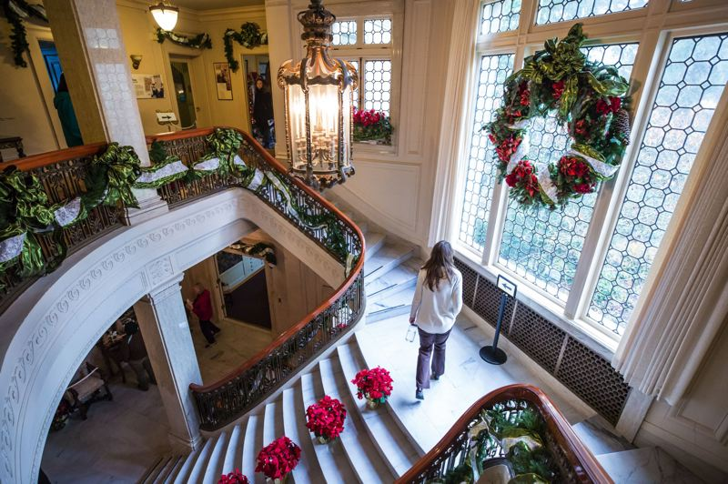TRIBUNE PHOTO: JONATHAN HOUSE - The grand staircase of Pittock Mansion is adorned for the holiday season.