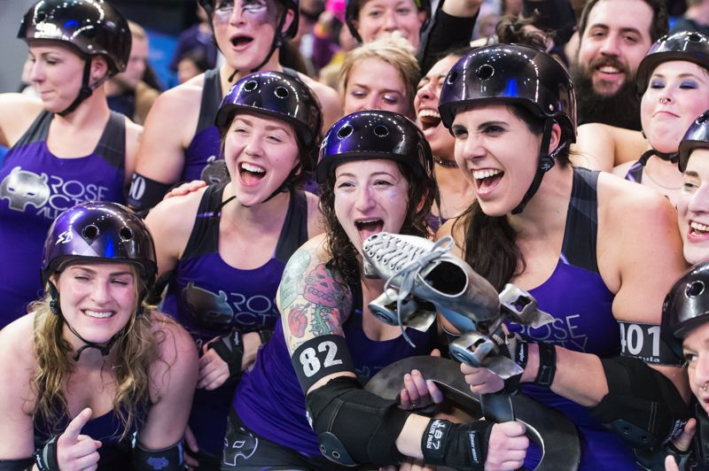 TRIBUNE FILE PHOTO: CHRISTOPHER OERTELL - The Rose City Rollers celebrate their second consecutive international title in roller derby at Memorial Coliseum.