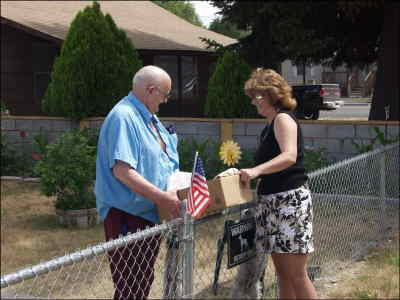 by: SHELBY CASE/CENTRAL OREGONIAN - Meals on Wheels deliverer Sabrina Brock visits for a few minutes with meal recipient Harry Hunter. Brock has been delivering meals for about five years and encourages others to volunteer.