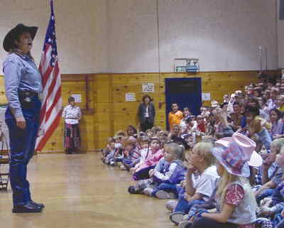 by: MICHELLE BERTALOT/CENTRAL OREGONIAN - Janie Rauch recently visited Ochoco Elementary School and spoke to students about the American flag and making good choices.