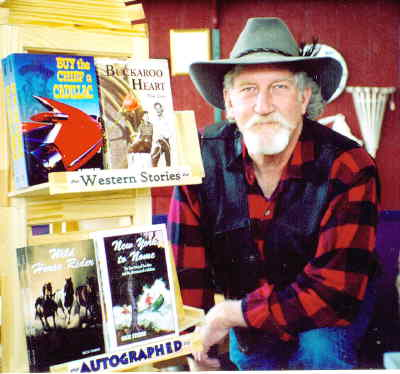 by: CONTRIBUTED PHOTOGRAPH - Rick Steber is shown with some of the books he's written, including