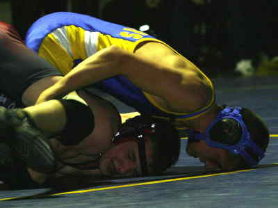 by: TIM STUMM/CENTRAL OREGONIAN - Mike Gast, on top, and the Cowboys head into this week's dual meets with a perfect 2-0 IMC record.