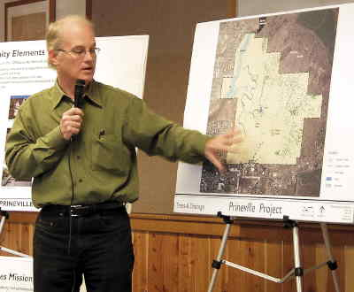 by: LORI KIMBEL/CENTRAL OREGONIAN - Mike Zillis, a partner with Walker Macy out of Portland, shows an ariel view of the proposed development site formerly known as Hudspeth Ranch. About 125 people attended the Saturday session at the Crook County Library.
