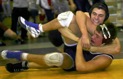 by: TIM STUMM/CENTRAL OREGONIAN - Trent Lucas wraps up a Mount Spokane (Wash.) opponent Thrusday at the 2004 Northwest Duals at Westview High School in Portland. Crook County lost their first meeting against Mt. Spokane 39-27 but went on to beat them 37-25 in the championships later that day.
