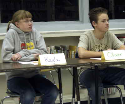 by: MICHELLE BERTALOT/CENTRAL OREGONIAN - Eighth-grade Kayla Miller and fellow student Oliver Ellsworth concentrate during the Crook County Middle School geography bee. She later went on to win the competition while Ellsworth came in second.