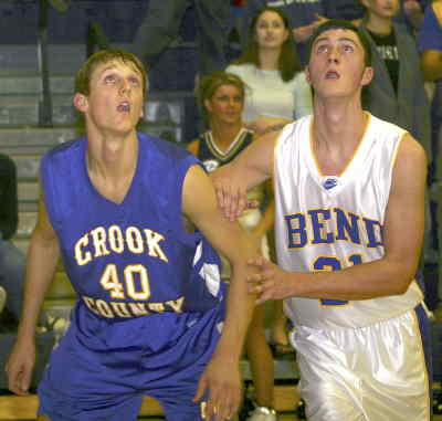 by: TIM STUMM/CENTRAL OREGONIAN - Senior Sean Santucci gets ready to box out a Bend defender Thursday night at Bend.