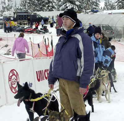 by: LORI KIMBELL/CENTRAL OREGONIAN - Students from Crook County High School Work Crew and Crook County Middle School Crossroads class helped at the Atta Boy 300. Shown in the photo above, Tyrell Cooper stands ready with musher dogs.