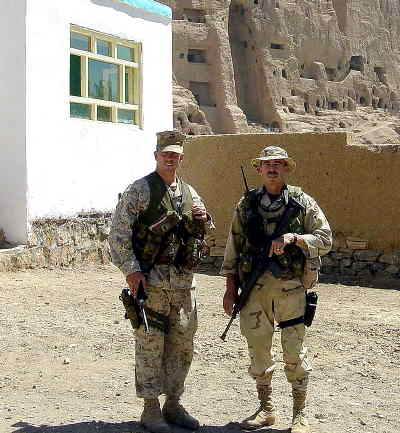 by: CONTRIBUTED PHOTO - The photo above, shows Pete Goodrich and a Marine officer he worked with briefly, at a house they refurbished for use by students from the newly reopened university in Bamiyan. The cliffs in the background are the famous
