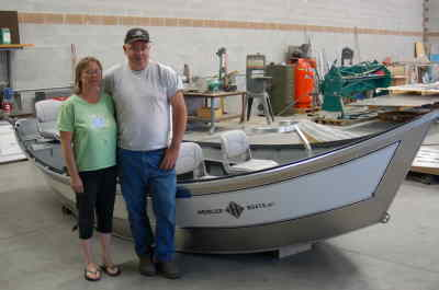 by: SCOTT STAATS/CENTRAL OREGONIAN - Clay and Candy Heisler stand next to one of their boats.