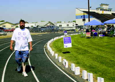 by: SHELBY CASE/CENTRAL OREGONIAN - Bob Zeigler of Prineville walks around the track at the Ward Rhoden Stadium on Saturday for the American Cancer Society's Relay for Life. As of about 11:15 a.m., Zeigler had completed 11 laps between both Friday and Saturday. Participants raised a little more than $50,000 to help fight cancer.