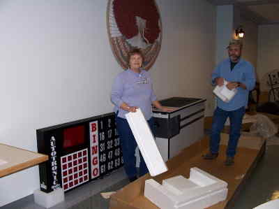 by: CONTRIBUTED PHOTO - This photo shows the new Bingo board as just unpacked by Bingo Chair Neva McPherson and John Koebrick. John's sister is a former Soroptimist and he is a Bingo volunteer.