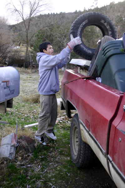 by: SHELBY CASE/CENTRAL OREGONIAN - Alfredo Vargas, 17, helps load trash from Wayne Eldridge's property to take to the Crook County Landfill. He was helped Monday afternoon by Baldemar Lopez, Mario Villagomez and Antonio Sanchez. Juvenile offender work crew members and youth volunteers have been helping beautify seniors' yards.