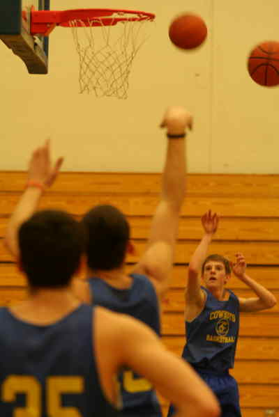by: ANDREW MATHESON/CENTRAL OREGONIAN - The Crook County Cowboys basketball team work on their fundamentals prior to tonight's game against the West Albany Bulldogs.