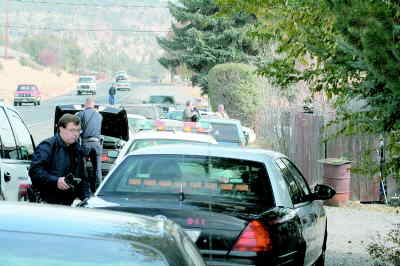 by: ANDREW MATHESON/CENTRAL OREGONIAN - Members of the Central Oregon Drug Enforcement Team execute a search warrant at a Prineville residence in early November, 2006.