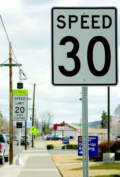 by: KATE WENNERSTROM/CENTRAL OREGONIAN - There has been some confusion among drivers about the speed limit signs by schools. Above, are road signs near Crooked River Elementary School on Third Street.