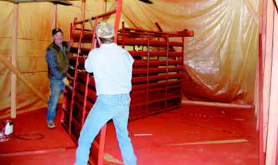 by: CONTRIBUTED PHOTO - Crooked River Roundup board members and volunteers have been working hard to improve safety conditions at the rodeo grounds. Larry Koops (left) and another volunteer are seen here with freshly-painted rodeo fencing.