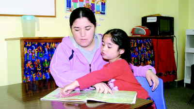 by: SHELBY CASE/CENTRAL OREGONIAN - Angelina Gonzalez reads with her daughter, Adriana, in the Even Start Family Literacy program. Organizers are seeking more students, as the program enters its 10th year in Prineville.