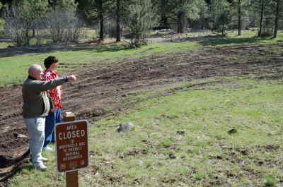 by: SCOTT STAATS/CENTRAL OREGONIAN - Chuck Gates (left) and R.J. Kleinschmit survey the mudded-up, rutted-up closed meadow. McKay Creek is in the background.