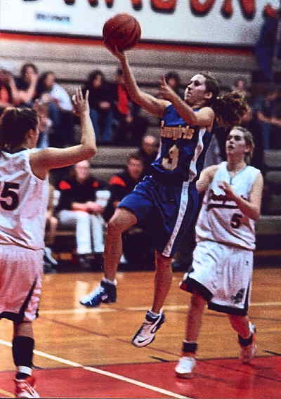 by: FRED HOUSTON JR/CENTRAL OREGONIAN - Kaitlyn Duncan goes up for two of her 11 points against Dallas on Tuesday.
