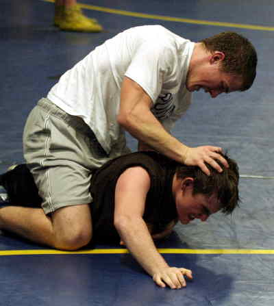 by: LON AUSTIN/CENTRAL OREGONIAN - Micah Perry wrestles during a recent practice.  Perry went 5-0 for the Cowboys during the Best of teh West  Tourney