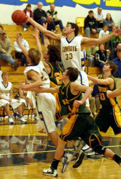 by: LON AUSTIN/CENTRAL OREGONIAN - David Reeher (33) and Daniel Teater (21) go for a rebound late in the game Saturday against the Pendleton Buckaroos.  Crook County won 51-48 after Reeher made two free throws in the final 15 seconds, and Pendleton missed a three-point shot off the front rim at the buzzer.