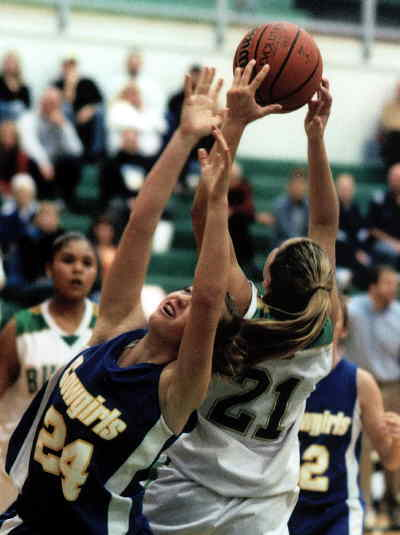 by: LON AUSTIN/CENTRAL OREGONIAN - Paige Buswell and a Pendleton player fight for a rebound during the Cowgirls victory over the Buckaroos on Saturday.