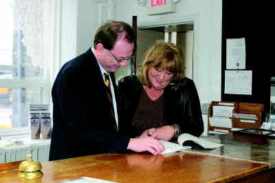 by: KEVIN GABOURY/CENTRAL OREGONIAN - Crook County Judge Scott Cooper reviews juvenile department records with Debbie Patterson, who is the Juvenile Department director.