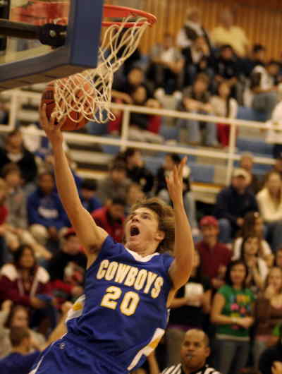 by: LON AUSTIN/CENTRAL OREGONIAN - Jordan Danforth goes up for two of his four points on Friday at Madras.  Crook County used good shot selection and great team defense and rebounding to defeat the White Buffaloes 88-67.