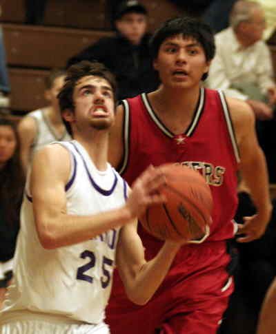 by: LON AUSTIN/CENTRAL OREGONIAN - Aaron Phillips drives tothe basket against Dufur.