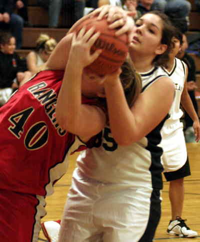 by: LON AUSTIN/CENTRAL OREGONIAN - The White Tigers Bekah Clements fights for a rebound with a Dufur player during their loss on Monday.