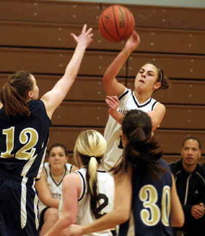 by: LON AUSTIN/CENTRAL OREGONIAN - Andrea Burcham goes up for two against Echo.