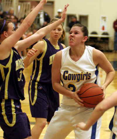 by: LON AUSTIN/CENTRAL OREGONIAN - Samantha Herrera goes strong to the basket against Hermiston during the cowgirls loss on Saturday.