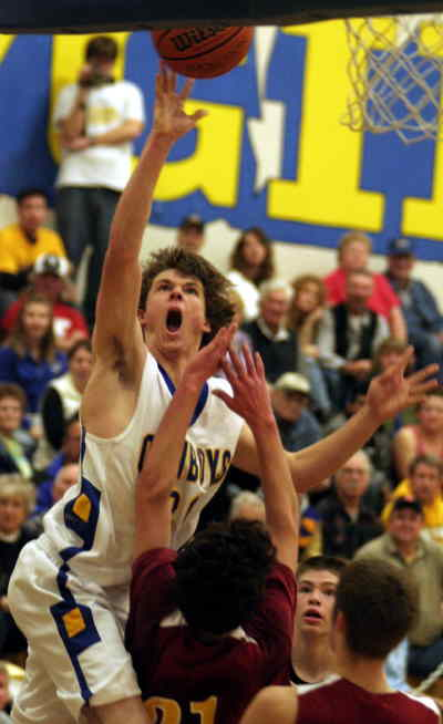 by: LON AUSTIN/CENTRAL OREGONIAN - Jordan Danforth goes strong to the basket during the Cowboys game against Crescent Valley.  Danforth made the basket and was fouled on the play.