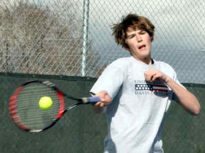 by: LON AUSTIN/CENTRAL OREGONIAN - Trevor Brown plays the ball during his match.