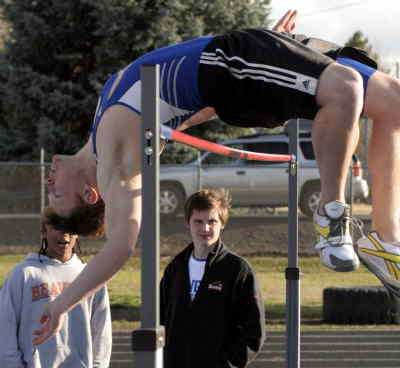 by: LON AUSTIN/CENTRAL OREGONIAN - David Parks clears a personal best 6-5 in the high jump during the Icebreaker Invitational at Ward Rhoden Stadium in Prineville on Tuesday.  Parks won the event as well as winning the 100-meter dash.