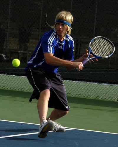 by: LON AUSTIN/CENTRAL OREGONIAN - Paul Robideau hits a backhand on Thursday.