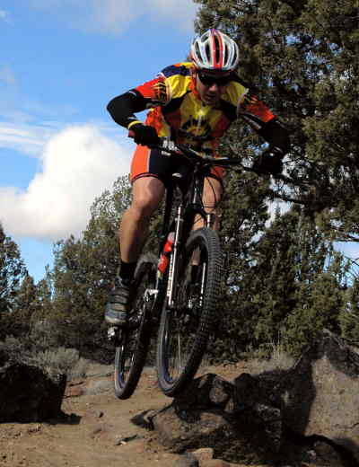 by: LON AUSTIN/CENTRAL OREGONIAN - Local mountain biker Don McLaughlin trains for the upcoming Oregon Cross Country Series which begins on April 6, in Portland.  McLaughlin commutes from Prineville to work in Los angeles.