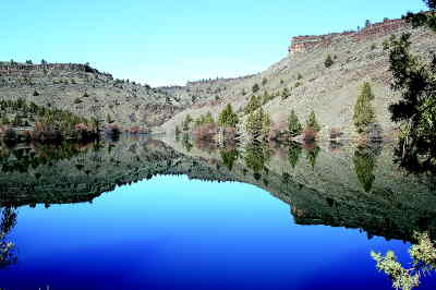 by: SCOTT STAATS/CENTRAL OREGONIAN - The calm waters of Lake Simtustus reflect the canyon walls.