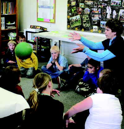 by: KEVIN GABOURY/CENTRAL OREGONIAN - The Prineville Branch of the Boys and Girls Club, which has been at its location on East First Street for nearly tow years, has to vacate the building by Aug. 1, 2008.  In the photo above, club staff member Evelyn Dubisar plays a game of ball with youth.
