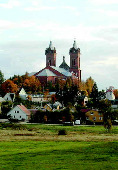 by: CONTRIBUTED PHOTO - The Church of Christ's Assumption in Kupiskis, Lithuania, towers over the surrounding buildings.