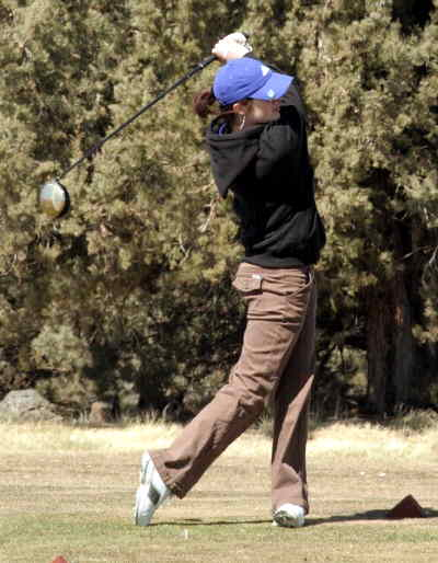 by: LON AUSTIN/CENTRAL OREGONIAN - Jo Beth Hamon tees off on the fourth hole at Eagle Crest Golf Course on Monday.  Hamon shot an 89 for the day.