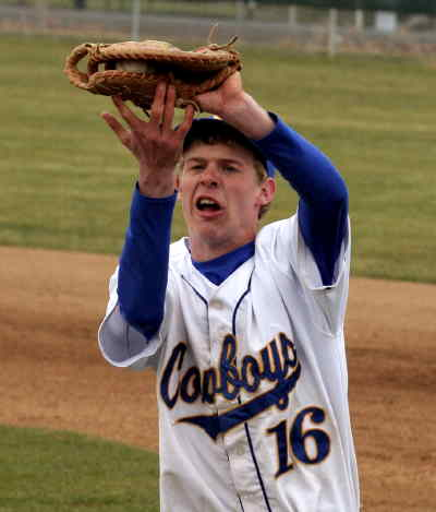 by: LON AUSTIN/CENTRAL OREGONIAN - Taylor Knox catches a foul ball during the Cowboys doubleheader against Hermiston on Saturday.