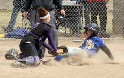 by: LON AUSTIN/CENTRAL OREGONIAN - Sami Verity slides safely into home in teh Cowgirls' second game against Hermiston on Saturday.  Crook County and the Bulldogs split a pair of games on teh day, with Hermiston taking game one 5-4 and the Cowgirls winning game two 7-1.