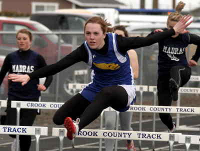 by: LON AUSTIN/CENTRAL OREGONIAN - Jessica Lea competes in the 100-meter hurdles on Tuesday against Madras.  Lea won both the hurdle race and the javelin.